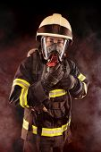stock photo of firefighter  - Firefighter with mask and protective suit with gas mask - JPG