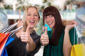 Smiling Young Women Having Fun While Shopping In A Shopping Mall