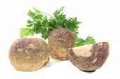 image of rutabaga  - rutabaga with parsley on a bright background - JPG