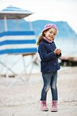 picture of little girls photo-models  - Portrait of 4 years old girl walking near sea in the city - JPG