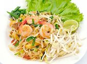 Homemade Asian Pad Thai with shrimp on white plate