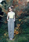 Glamor. Trendy Stylish Fashion Model In Elegant Pants Outdoors