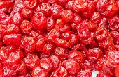 Dried cranberry background or red food texture