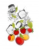 Falling pieces of apricots, strawberries and nectarines in water splash and ice cubes, isolated on w