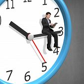 Businessman Sitting On Clock Pointer