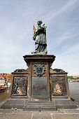 Statue Of Sf. John Of Nepomuk On The Charles Bridge
