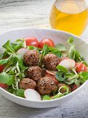 mixed salad with vegetarian meatballs slice radish and  soy sprout