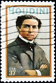 stamp printed in USA show great American magician Harry Houdini