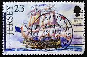 JERSEY - CIRCA 2004: A stamp printed in Jersey showing a sailing ship with the flag of UK