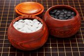 Black And White Go Stones In Wooden Bowls