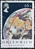 UNITED KINGDOM - CIRCA 1984: A stamp printed in Great Britain shows red line on Globe