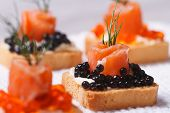 Canapes With Black Sturgeon Caviar And Salmon Macro