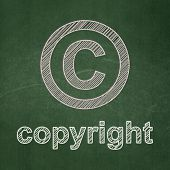 Law concept: Copyright and Copyright on chalkboard background