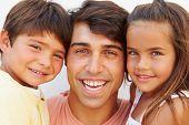 Portrait Of Hispanic Father With Children