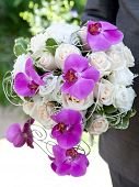 Wedding bouquet. Bouquet of fresh flowers for the wedding ceremony. Bouquet of orchids, roses and ot