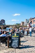 View over pedestrian area of River Ouse and bridge in the city of York UK