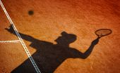 Clay tennis court and player concept