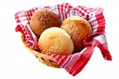 Tasty buns with sesame isolated on white