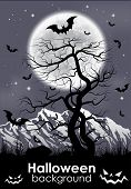 Halloween background with foll Moon and lifeless tree.