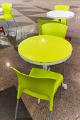 Plastic Tables And Chairs In A Cafe