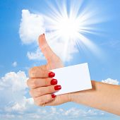 Hand shows thumbs up, Sky and sun
