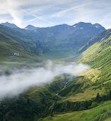 Composite of low hanging cloud in La Peule valley, Switzerland, with Perc�?�?�?�© Mountain in t
