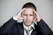 Tired Businessman With Stress Headache