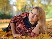young woman relaxing in autumn park
