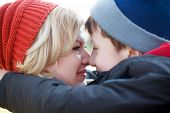 pic of huddle  - Mother and son huddle together winter portrait closeup - JPG