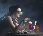 alchemist girl with test tubes in hand