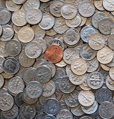 one cent coin on pile of 10 cent coins