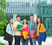 friendship, business, education and people concept - group of smiling teenagers with folders and sch
