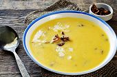 pic of chanterelle mushroom  - pumpkin soup with chanterelles on a dark wood background - JPG