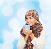 happiness, winter holidays, christmas, beverages and people concept - smiling young woman in warm cl