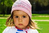 Cute kid thinking at the park