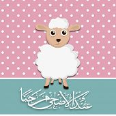 Muslim community festival of sacrifice Eid-Ul-Adha greeting card with sheep and arabic islamic calligraphy of text on abstract vintage background.