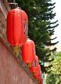 A red lanterns hung on the wall