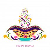 Colorful floral design decorated illuminated oil lit lamp for Hindu community festival Happy Diwali
