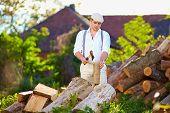 Man Chopping Wood On The Backyard