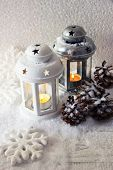 White and metal flash lights and Christmas decoration on light background