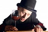 foto of dracula  - Man dressed up as Dracula with black hat for the halloween - JPG