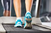 stock photo of treadmill  - Woman running on treadmill in gym closeup - JPG