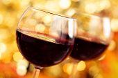 Fresh Wine Against Autumnal Lights Background.