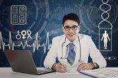 Doctor In Hospital With Virtual Screen