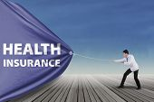 Doctor Pulling A Health Insurance Banner