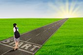 Girl Walking On The Road To Start Her Future