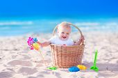 Baby In A Basket On The Beach
