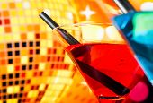 Detail Of Cocktail With Sparkling Disco Ball Background With Space For Text