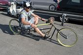 man driving bicycle chopper