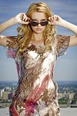 portrait of beautiful attractive and sensuality young adult blonde pretty woman in sunglasses  and m